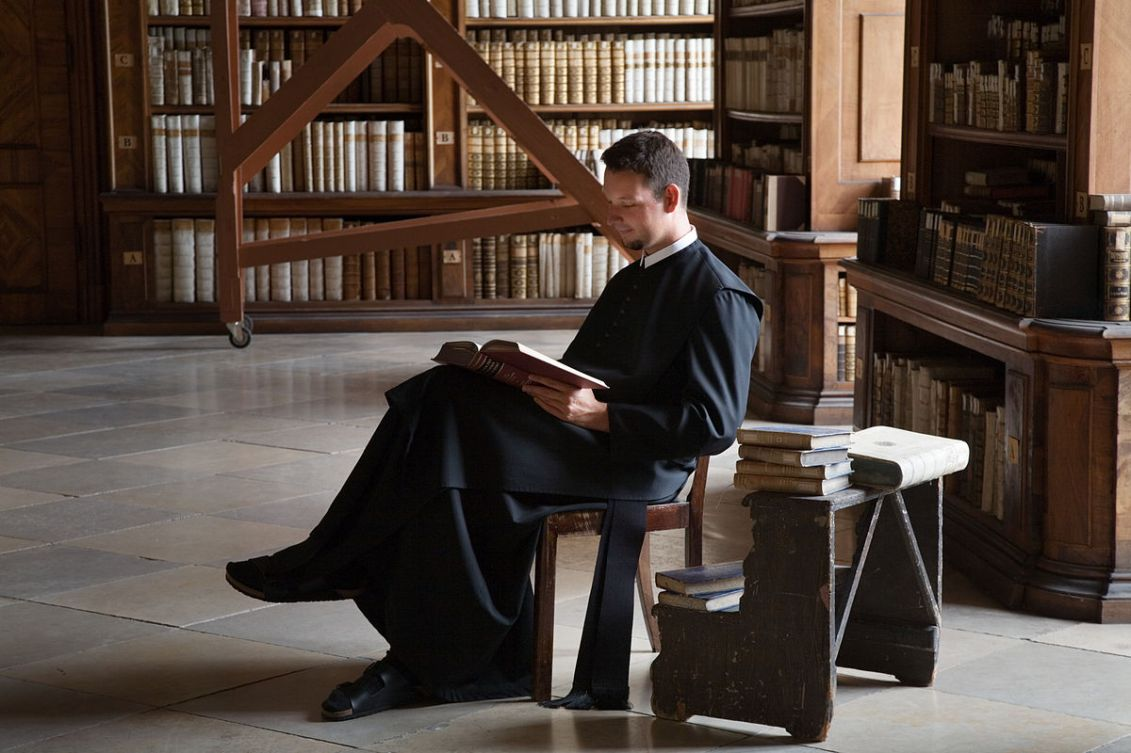Priest Reading in Library of Göttweig Abbey in Austria. By Jorge Royan